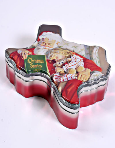 "The ""Christmas Stories"" Santa Tin is a ""Limited Edition"" production. The cover is a digital reproduction of a painting titled ""Christmas Stories"", by world famous artist Tom Browning. Yes, the same guy who did the Coca-Cola Santa. We don't have many left."